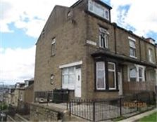 Large end of terrace property for sale currently in 4 flats Bradford