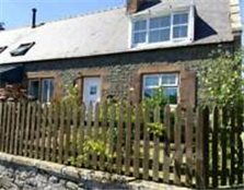 Semi detached two bedroom cottage with garage